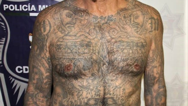 "Tattoos of a suspected Barrio Azteca ""sicario"" arrested by Juárez police."