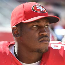San Francisco 49ers outside linebacker Aldon Smith (99) watches from the sideline during the third quarter against the San Diego Chargers at Levi's Stadium. The 49ers defeated the Chargers 21-7.