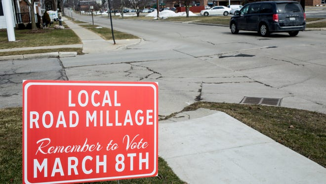A road sign reminds voters of the local road millage Tuesday, March 8, 2016 in St. Clair. Voters will consider a 2.4902 mill tax renewal to help fund residential road projects, generating roughly $470,066 annually starting in 2017.
