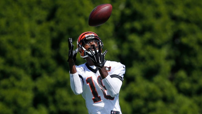 A.J. Green catches a pass during training camp Friday.
