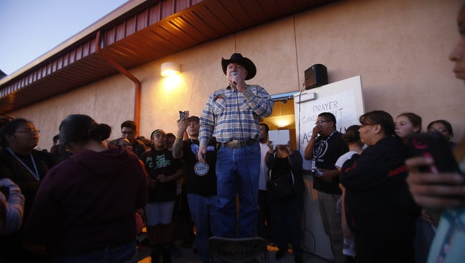 Gary McDaniel, a civil deputy with the San Juan County Sheriff's Office, informs the crowd outside the San Juan Chapter house in Lower Fruitland on Tuesday evening that a suspect was arrested in the abduction and murder of Ashlynne Mike. The FBI said that 27-year-old Tom Begaye has been arrested in connection to the girl's death.