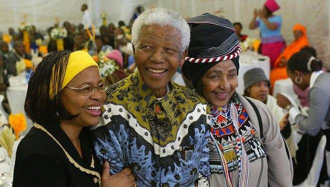Nelson Mandela celebrates his 86th birthday with his wife Graca Machel (l) and his ex wife Winnie Madikizela Mandela (R) at Mandela's birth town of Kunu in the Eastern Cape, July 18,  2004.