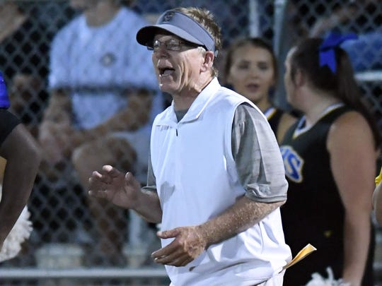 Sumrall head coach  Shannon White yells from the sideline in a game against Richton on Friday.