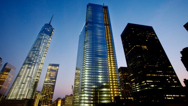 Four World Trade Center, center, stands next to One World Trade Center, left, in lower Manhattan on Sept. 11, 2013 in New York.