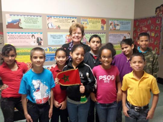Eneida Dianderas poses with some of her students at Henry Houck. From left to right: Leanna Núñez Pérez, Elvin Torres Seda, Jonairys Rodríguez López, Hidaya Amina Benkhak, Lizmel Polanco Báez and Dereck Báez Rodríguez
