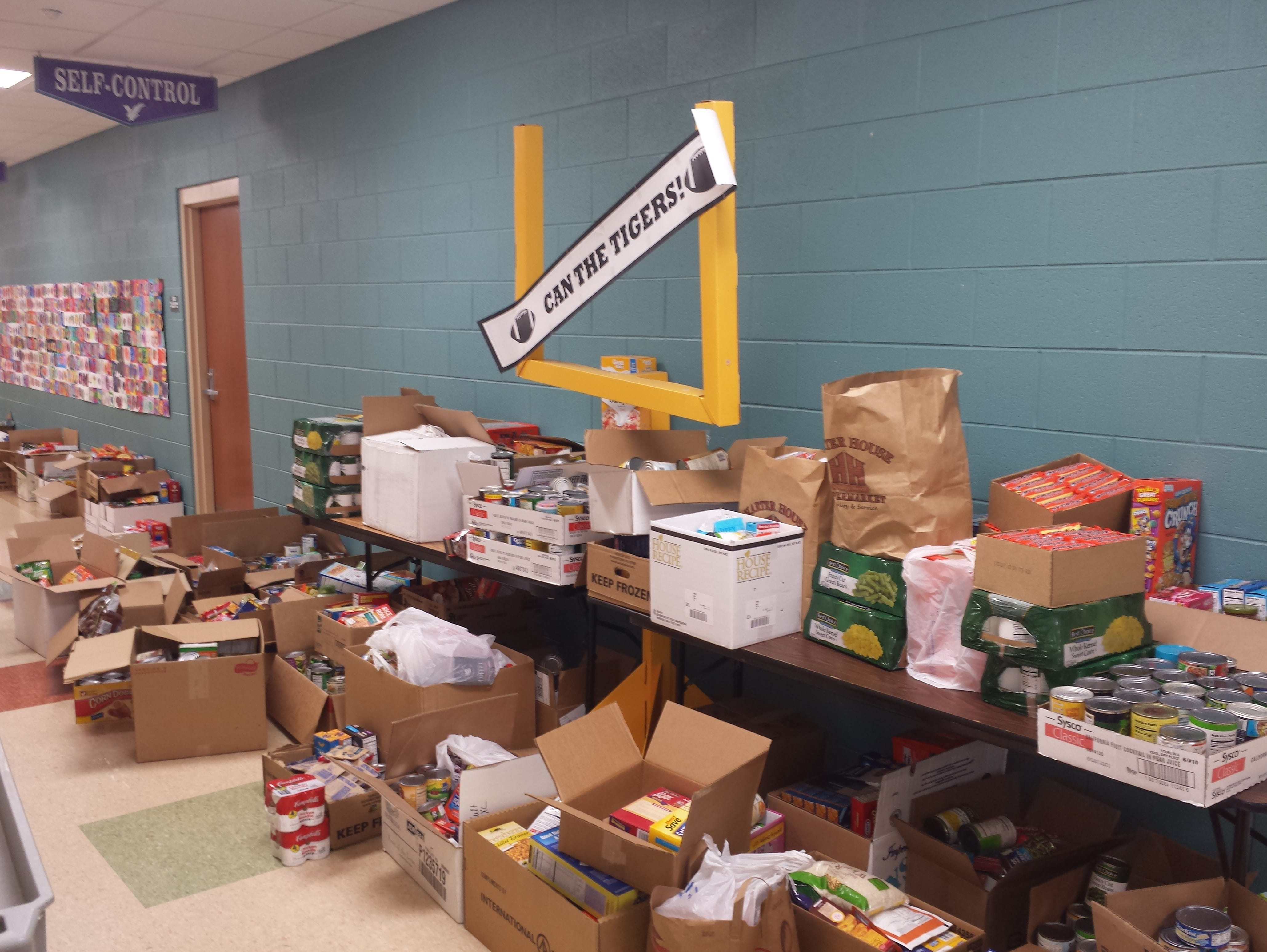 The ninth annual Can the Tigers, Can the Eagles food drive competition generated almost two months of worth of food for Least of These.