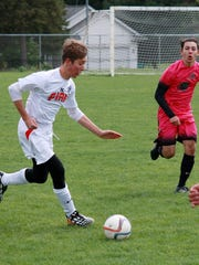 Benjamin Swagler from St. Philip Catholic Central dribbles during the Battle Creek Fire's Soccer match Sunday