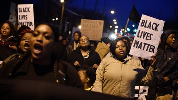 Residents march down Shelby Avenue on Tuesday, Feb. 14, 2017, in protest of the officer-involved shooting of Jocques Clemmons in Nashville.