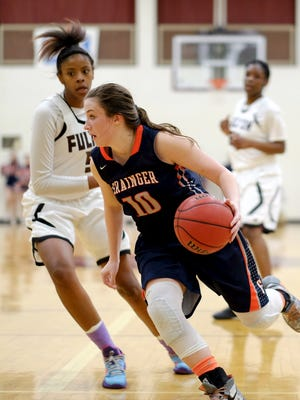 Grainger's Karli Combs (10) dribbles the ball against Fulton's Keke McKinney (5) during the 2-AA state sectional at Fulton on Saturday, March 5, 2016. Grainger defeated Fulton 54-52.  (Shawn Millsaps/Special to News Sentinel)