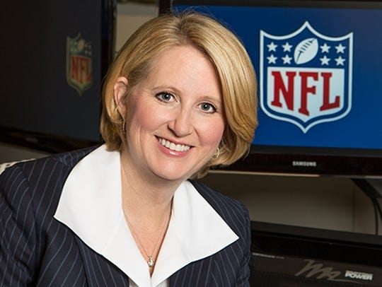 Michelle McKenna-Doyle, a 1987 Auburn graduate, was one of the first female executives in the NFL.