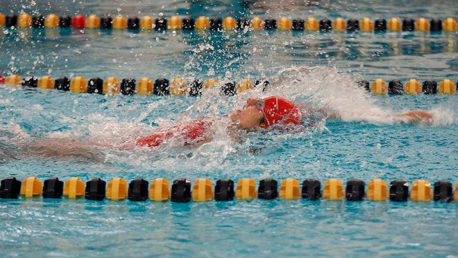 Waverly-Lansing Catholic's Joy El Jbeily competes in the 200 backstroke relay at the Waverly Relays, Wednesday, Aug. 23, 2017, at Waverly High School.