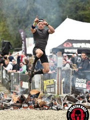 Team Little Giants' Coey Raymo jumps over fire as part