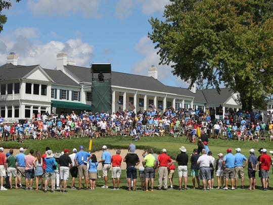 Fans watch action on the 18th hole during the final