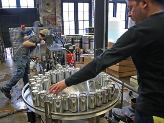635896870575864519-012916mobile-canning.jpg