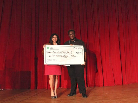 Startup Star winner Jabriel Crawford-Bell stands with his $750 check