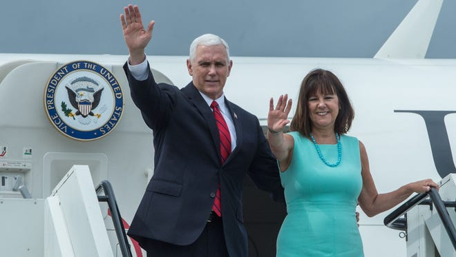 US Vice President Mike Pence and his wife Karen Pence wave as they board their plane to leave Estonia at the airport in Tallinn on July 31, 2017. Estonia was the first stop of Pence's European tour which will also take him to Georgia and Montenegro.