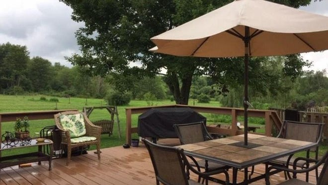 The home at 3241 South Hill Road, McKean, includes this deck overlooking more than 21 acres of property known as Trotterville Farms.