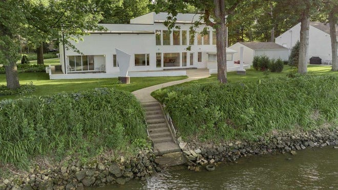 This contemporary home on the Rock River at 12416 Harbor Oaks Drive, Machesney Park, features an open concept layout.
