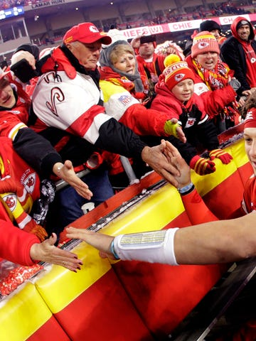 Fans congratulate Kansas City Chiefs quarterback Patrick Mahomes, right, as he comes off the field after an NFL divisional playoff football game against the Houston Texans, Sunday, Jan. 12, 2020, in Kansas City, Mo. (AP Photo/Charlie Riedel)