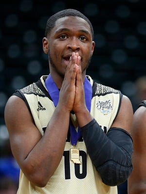 Warren Central Warriors Dean Tate (10) celebrates following the IHSAA 4A boys basketball state finals game at Bankers Life Fieldhouse on Saturday, March 24, 2018. The Warren Central Warriors  defeated the Carmel Greyhounds  54-48.