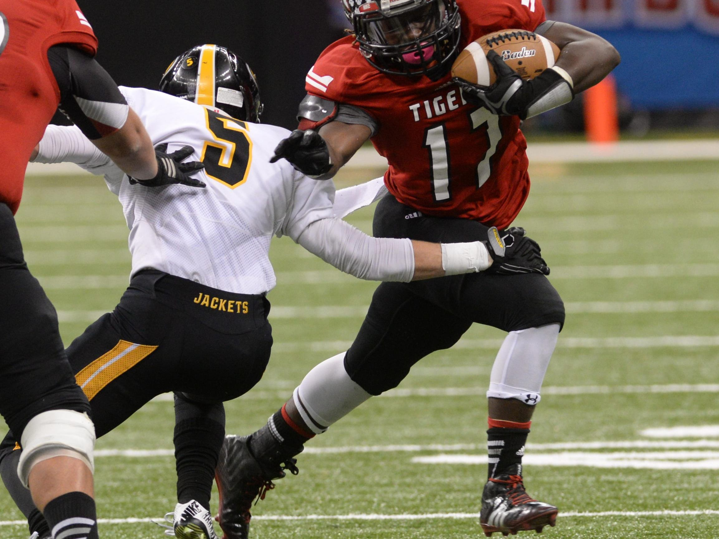 Many's Kentrell Maxie runs for a first down in the second quarter of the 2014 LHSAA Class 2A championship game with Kinder in the Mercedes-Benz Superdome. Maxie is one of two 1,200-yard rushers returning for the Tigers.