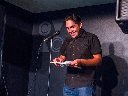Aspiring poet Francisco Rodriguez reads his poem for poet laureate Juan Felipe Herrera on Friday at the Coachella Valley Arts Center in Indio. Herrera listened in via Skype.