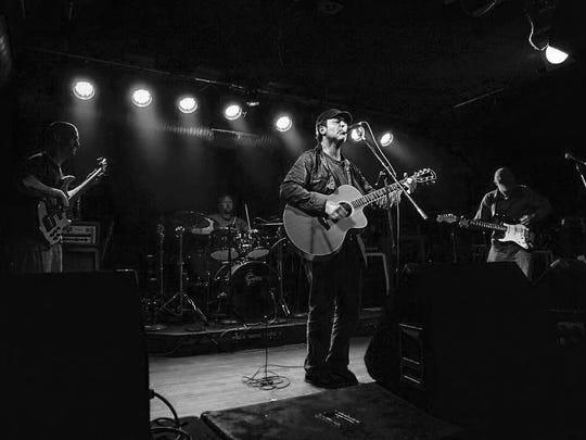 Local musician Eddie Gumucio performs with The Bandoleros.