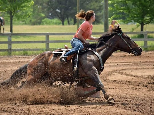MSU junior Taylor Whaling puts her horse named Cracks Royal Memory (or fondly called Crackhead) through some paces.
