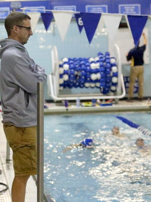 Horseheads coach Mark Miles watches as his swimmers practice Tuesday at Horseheads High School.