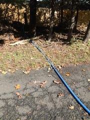 A hose leads from a nearby property into the Ateres