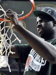 MSU senior Draymond Green helps cut down the nets in