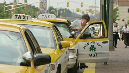 Driver Jairo Navarrette pulls his taxi cab up to the curb on the Maryland Street side of The Westin Wednesday. Cabs often wait there for airport fares, Wednesday, June 26, 2002.