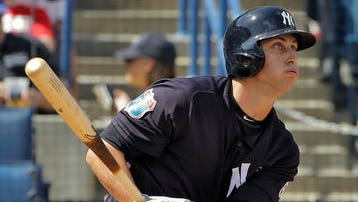 New York Yankees' Dustin Fowler hits a double off Toronto Blue Jays starting pitcher Drew Hutchison during the third inning of a spring training baseball game Thursday, March 10, 2016, in Tampa, Fla. (AP Photo/Chris O'Meara)