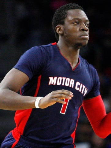 Detroit Pistons guard Reggie Jackson dribbles the ball