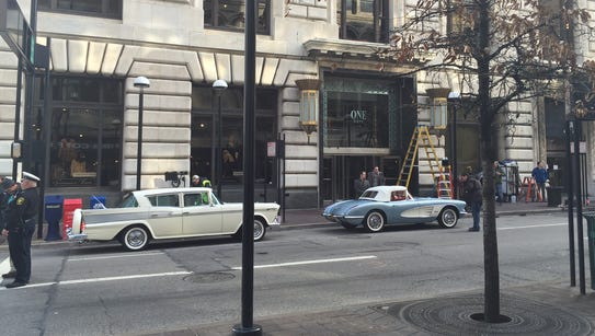 A Rambler and Corvette parked on Fourth Street west