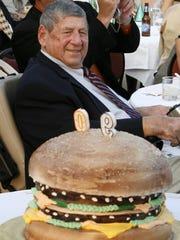 "Big Mac creator Michael ""Jim"" Delligatti sits behind a Big Mac birthday cake at his 90th birthday party on Aug. 21, 2008, in Canonsburg, Pa."