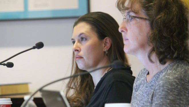 In this Dec. 2016 file photo, Commissioners Erica Martin and Jenny Turnbull listen to a presentation. On Tuesday evening, Martin publically submitted her resignation. Her District 6 seat will remain vacant until a special election is held in March.