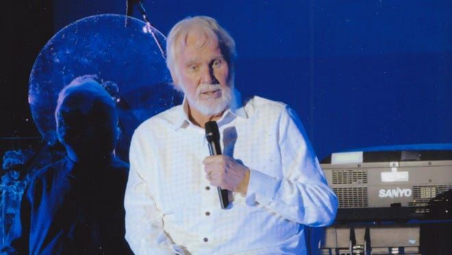 Kenny Rogers performs at a farewell concert.