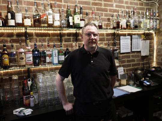 Scott Roberts, manager of The Pompei Lounge, stands behind the bar for a portrait on Wednesday evening.