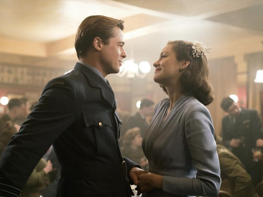 "Marion Cotillard, right, and Brad Pitt appear in a scene from ""Allied."""