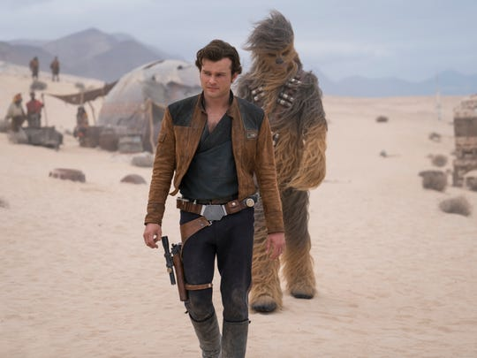 "This image released by Lucasfilm shows Alden Ehrenreich and Joonas Suotamo in a scene from ""Solo: A Star Wars Story."" (Jonathan Olley/Lucasfilm via AP)"