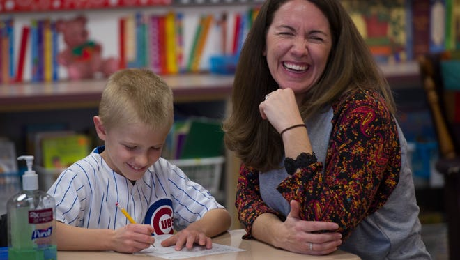 Third-grader teacher Libby Butcher makes learning fun for her class, including Taylor George, left, as they learn about telling time at Elberfeld Elementary School Tuesday morning, March 21, 2017.