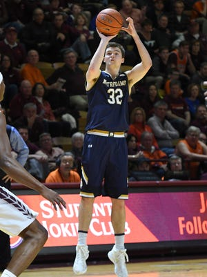 Notre Dame Fighting Irish guard Steve Vasturia (32) shoots a three pointer against the Virginia Tech Hokies in the first half at Cassell Coliseum.