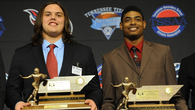 Jack Jones of Oakland High School and Jauan Jennings of Blackman High School accept their Tennessee Titans Mr. Football Awards Monday Dec. 1, 2014, in Murfreesboro, Tenn.
