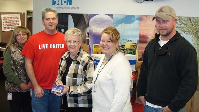 Eaton Corporation employees recently presented Kay Owens, Mountain Home Food Basket Board vice president and food drive coordinator, with 366 pounds of food and two $500 gift cards. Shown are (from left): Oleta Martin and Brad Gregg, Eaton employees; Owens; and Denise Hill and James Wagner, Eaton employees.