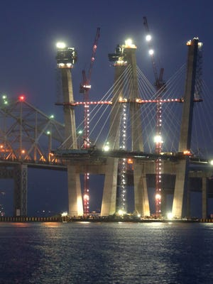 Cables are hung from the westbound main span of the new Tappan Zee Bridge as the eastbound span towers continue to rise Nov. 25, 2016.