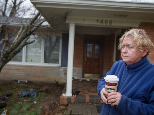 Susan Cothran, stands in front of her home on Locust Lake Road in Pierce Township. That area was one of the harder hit areas when severe storms tore through region overnight. She said she was awaken around 4:30 a.m. when the sirens went off. Seconds later, her back window blew out.