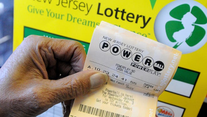 Al Drummond of Vineland shows off his New Jersey Lottery Powerball ticket at Todd's News Agency on Delsea Drive in Vineland Sunday January 31, 2010, the first day for the sale of Powerball tickets in the state of New Jersey. Ticket sales for multi-state lotteries like Powerball have been slumping.