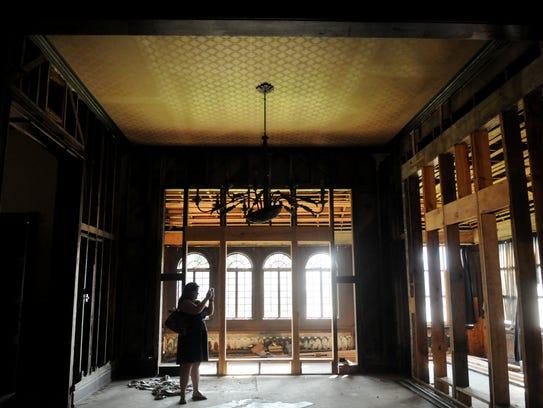 Casey Ardoin looks around the main floor of the Ogilvie-Wiener