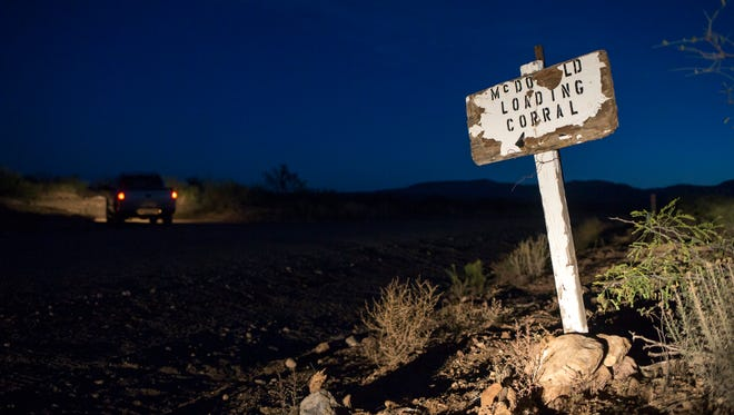 A sign marks the turnoff for Bill McDonald's loading corral at Sycamore Ranch in Douglas, Arizona.